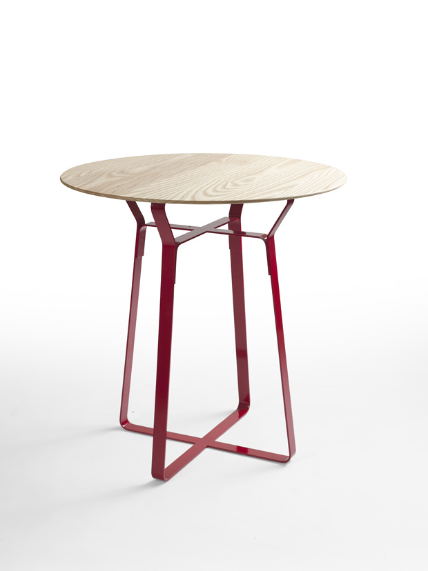 Helen Kontouris' 'Penelope'  table uses light bands of steel in conjunction with a solid oak top. Offered in various colours, three diameters and two heights, the table broaches both residential and commercial environments.
