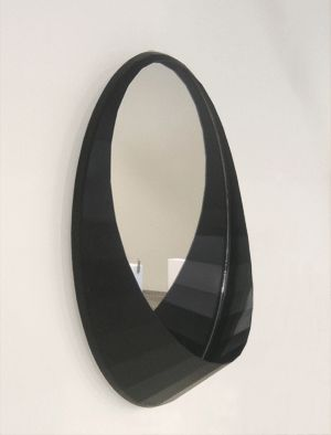 The 'Orson' mirror has a facetted surround with a shelf within the shape for keys and the like.