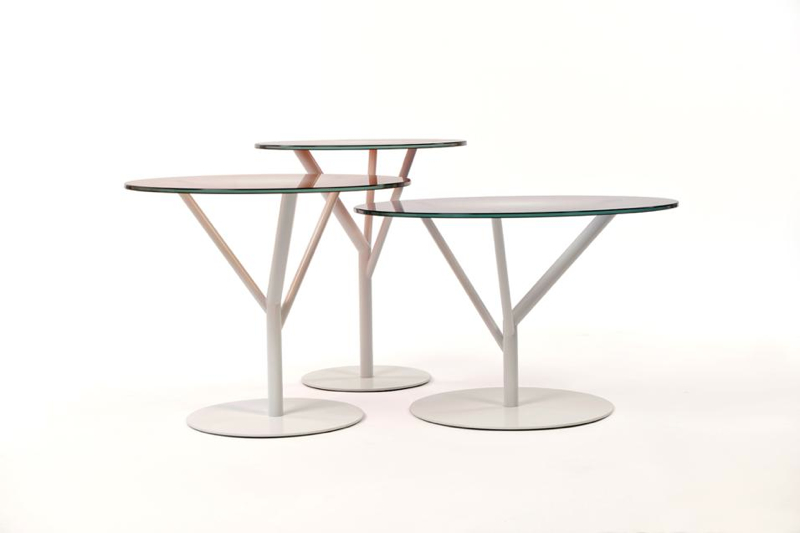 The 'Spring' tables by Thomas Eurlings feature coloured glass tops in ruby, beige and light mauve on a branch-like white steel base.