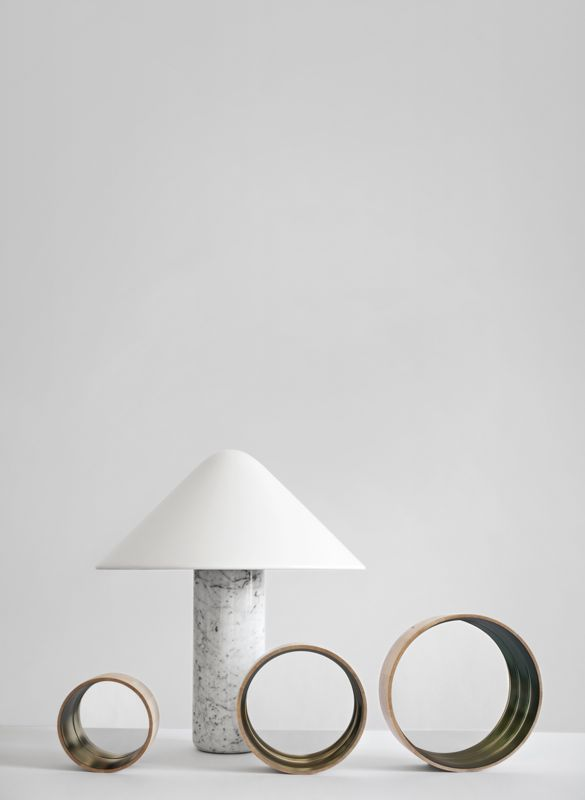 The 'TOPP' lamp for Established & Sons released in 2011. Shown here as a marble prototype. The lamp was finally released in resin in white, black and yellow - all with a white aluminium shade.