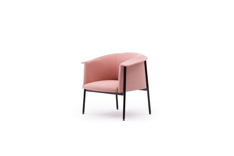 "The ""Kavai' chair for H.K. Hjelle. It's collar-like armrest and back and fine metal frame are the key elements."