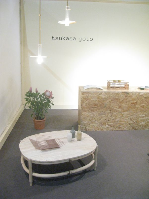 Tsukasa Goto's 'Oval' coffee table in stone and timber.