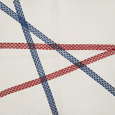 A close up of the bicycle tire inspired print of the 'Lugo' tablecloth byLeonardo Jonnoli & Irene Bacchi.