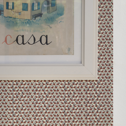 The 'Paesemio' wallpaper features tiny interconnecting white houses as its motif. Printed by Jangelli & Volpi.
