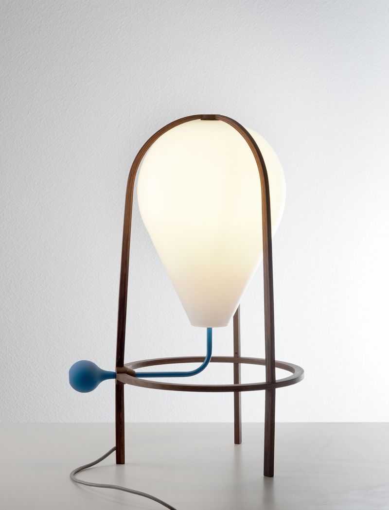 De Lafforest's 'Olab' table lamp uses fine plywood and moulded glass but adds a quirky dimming mechanism.