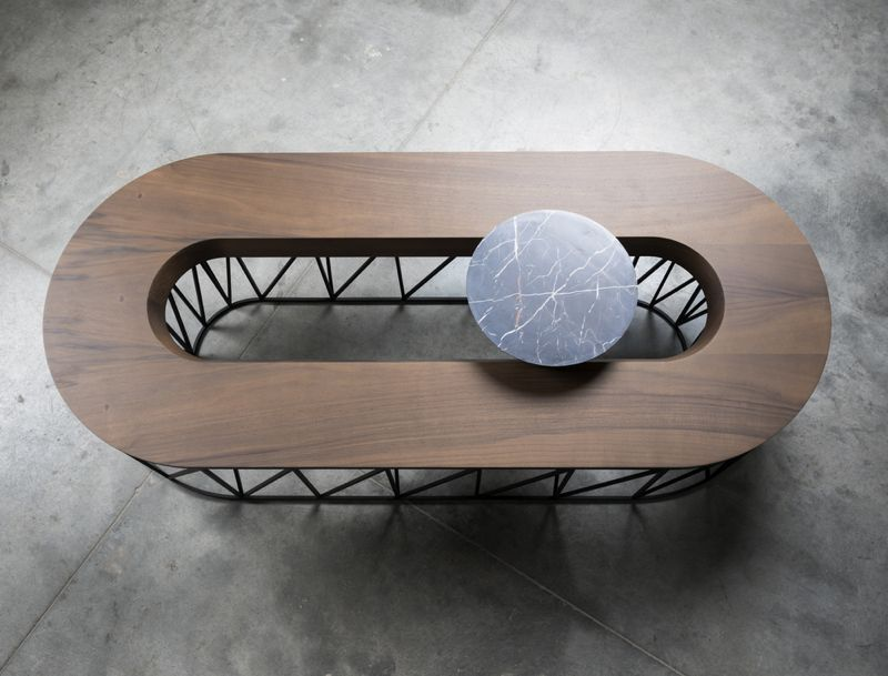 An overhead image of the 'EXO' seating bench emphasises the relationship between the oval and circle shapes.