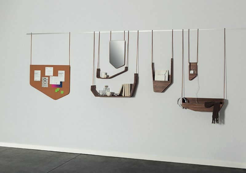 The 'Vola' wall mounted shelving system borrows a hanging concept normally found in art galleries.
