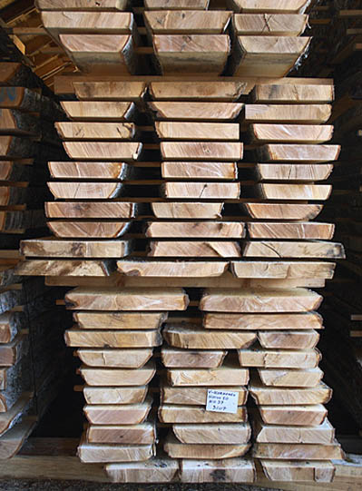 Rough sawn timber stacked for drying. Nikari only uses sustainably grown timber from local forests.