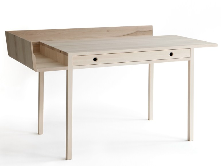 Louise Campbell's 'November' desk for Nikari. Made from solid maple the desk offers austerity with a twist.