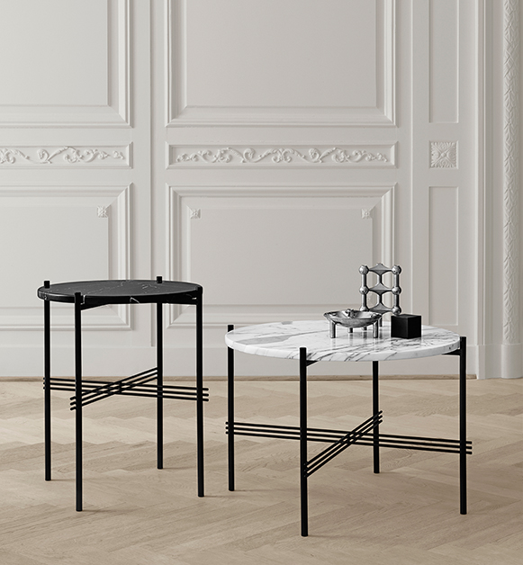The 'TS' tables by GamFratesi for Gubi in Nero Marquina and Bianco Carrara marbles.