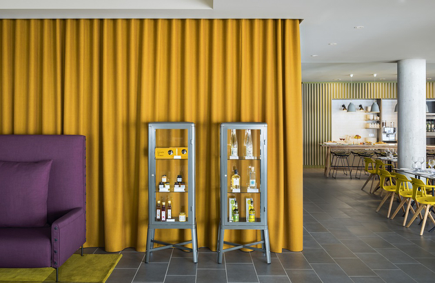 Strong colours in The Club area work well against the palette of grey tiles and concrete.