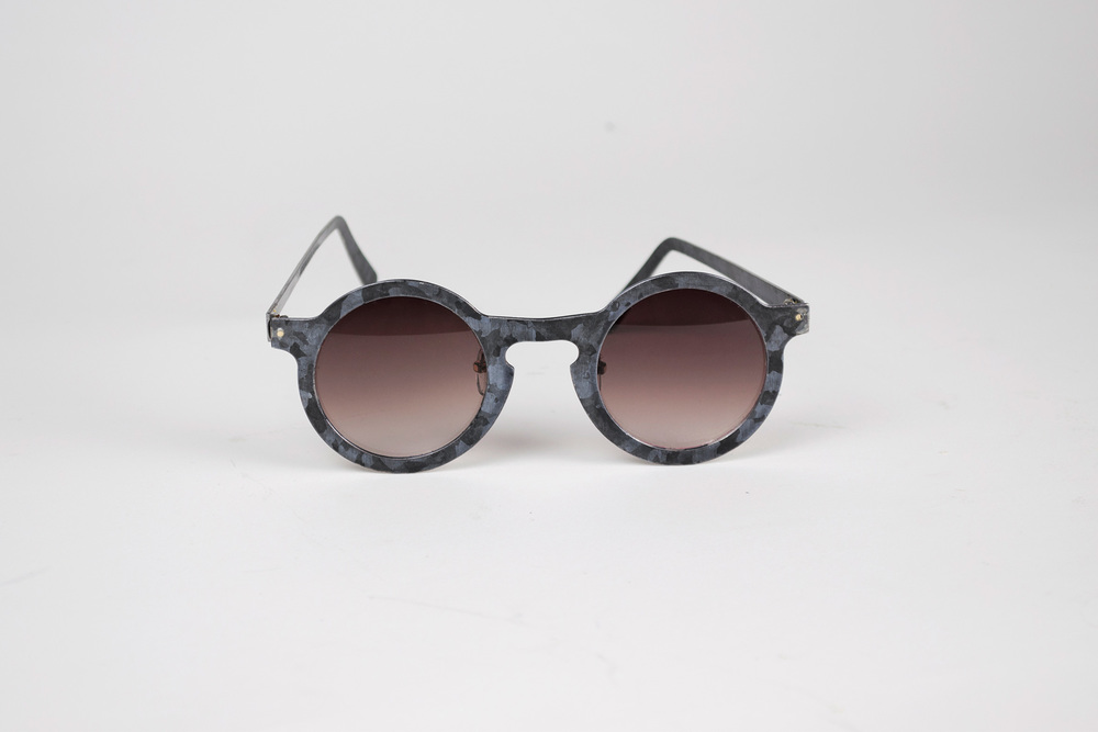 Galvanized sunglasses create a sort of crystalline camouflague look.