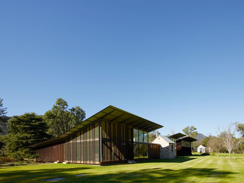 Virginia Kerridge designed this house in the Hunter Valley to incorporate a small stone cottage that was once used by a local biushranger. The rest of the structure references traditional farm buildings.