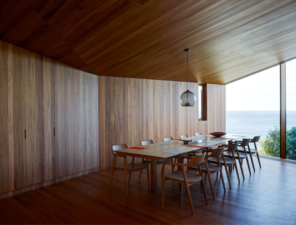 The dining room is in the corner of an 'L' shape that has the lounge room as one arm and the kitchen as the other. Views are highly controlled.