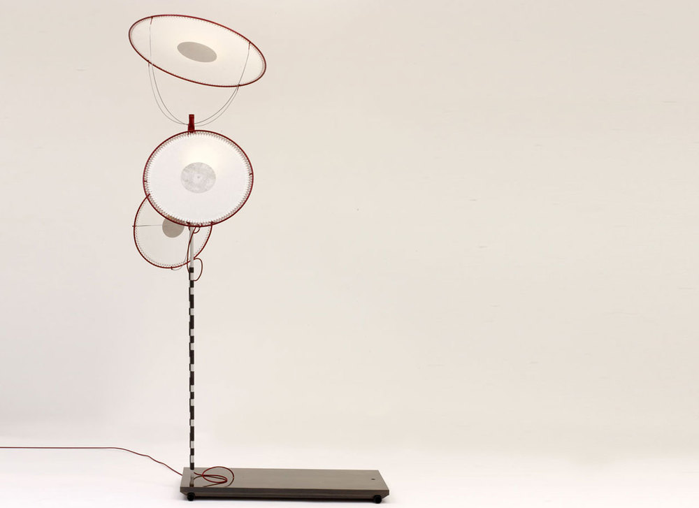 The 'Rei' lamp references a traditional doll that dances while holding several hats.
