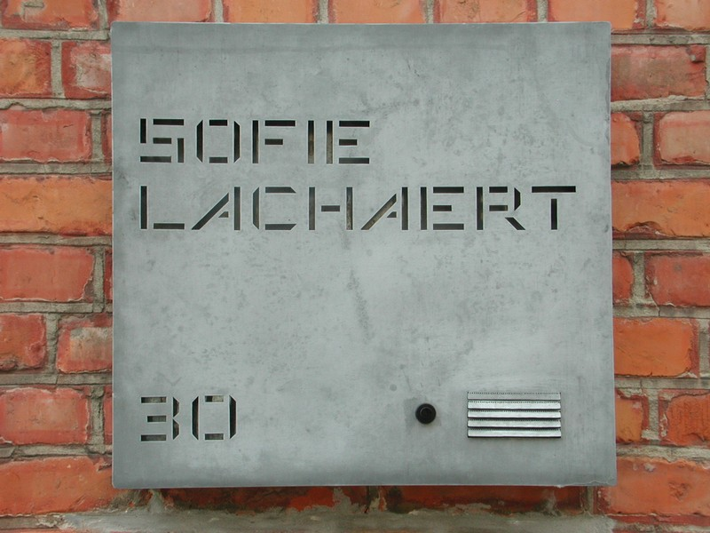 The simple signage and red brick facade of Galerie Sofie Lachaert gives nothing away.