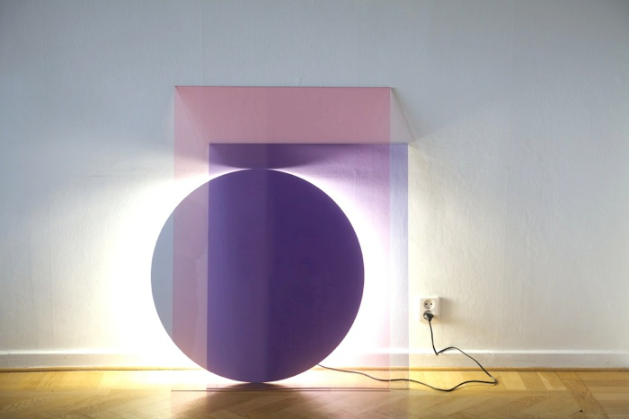 'Colour' - a layering of three glass shapes in subtle colours combined with a simple circular fluorescent tube. Photography by Kalle Sanner and Daniel Rybakken.