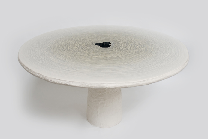 Study O Portable's monolithic 'Fuzz D' table -  hundreds of layers of acrylic resin are rolled then sliced.
