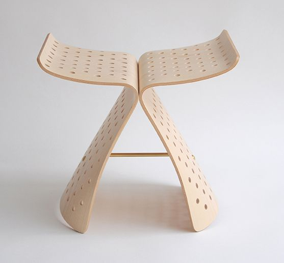 Jasper Morrison's perforated 'Butterfly' stool adds a rigid pattern to the sweeping wings.