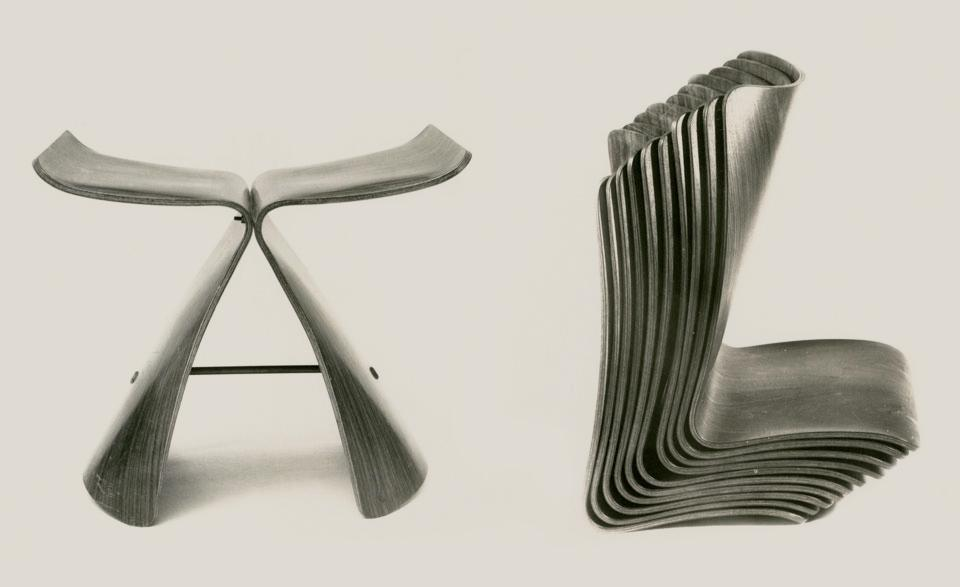 An archive image of Sori Yanagi's Butterfly stool showing the stacking ability of its parts.