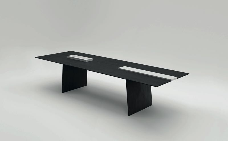 The 'Kanji' table by Francesco Rota for Paola Lenti. The table features removable glazed ceramic inserts.