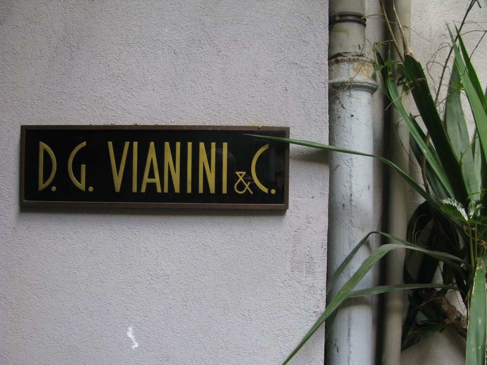An old sign in a courtyard off via Solferino in Brera. How about the typeface?