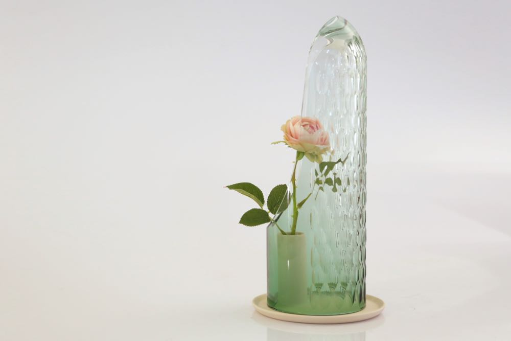 A vessel for displaying a single flower by Turkish designer,  Bilge Nur Saltik . The cut-glass creates multi-faceted versions of the flower. The designer showed three different versions in different sizes and colours.