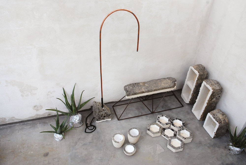 More of Frascina's roughly hewn objects in local stone along with some of hiscast concrete vessels.