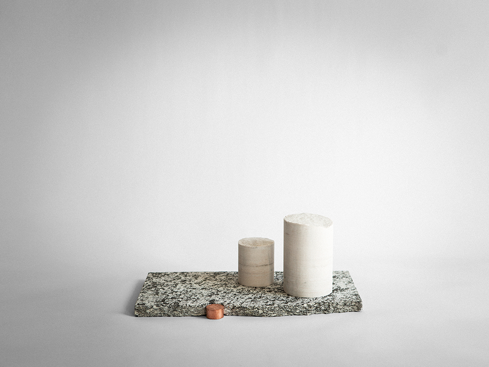 One of the pieces from Studiopepe's  Ossimori  exhibition. Broken columns of marble sit on top of a granite plinth with a natural hewn edge and copper detail. Photo: Silvia Rivoltella