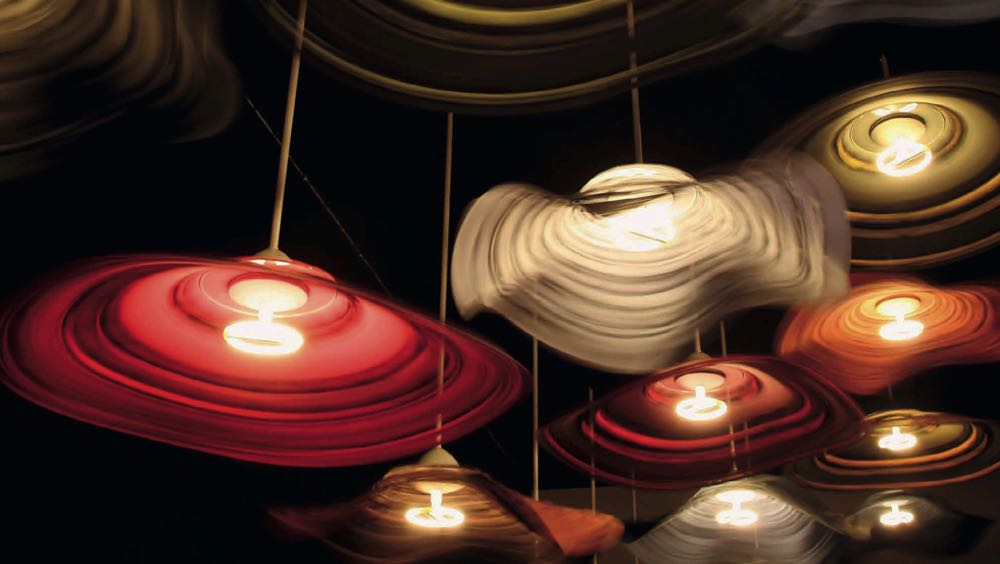 'Les Danseuses' spinning pendant lights by Atelier Oï for Danese.