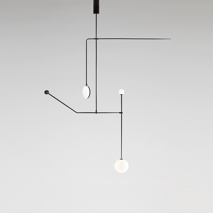 Shown is his 'Mobile Chandelier 6' in black painted brass and mouth blown glass  - one of 8 new lights.