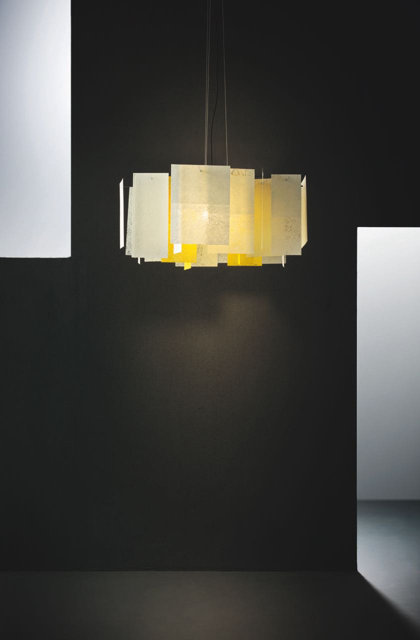 The 'Alexandra' pendant by Enrico Franzolini for  Pallucco  is made from sheets of paper-like fibre glass.