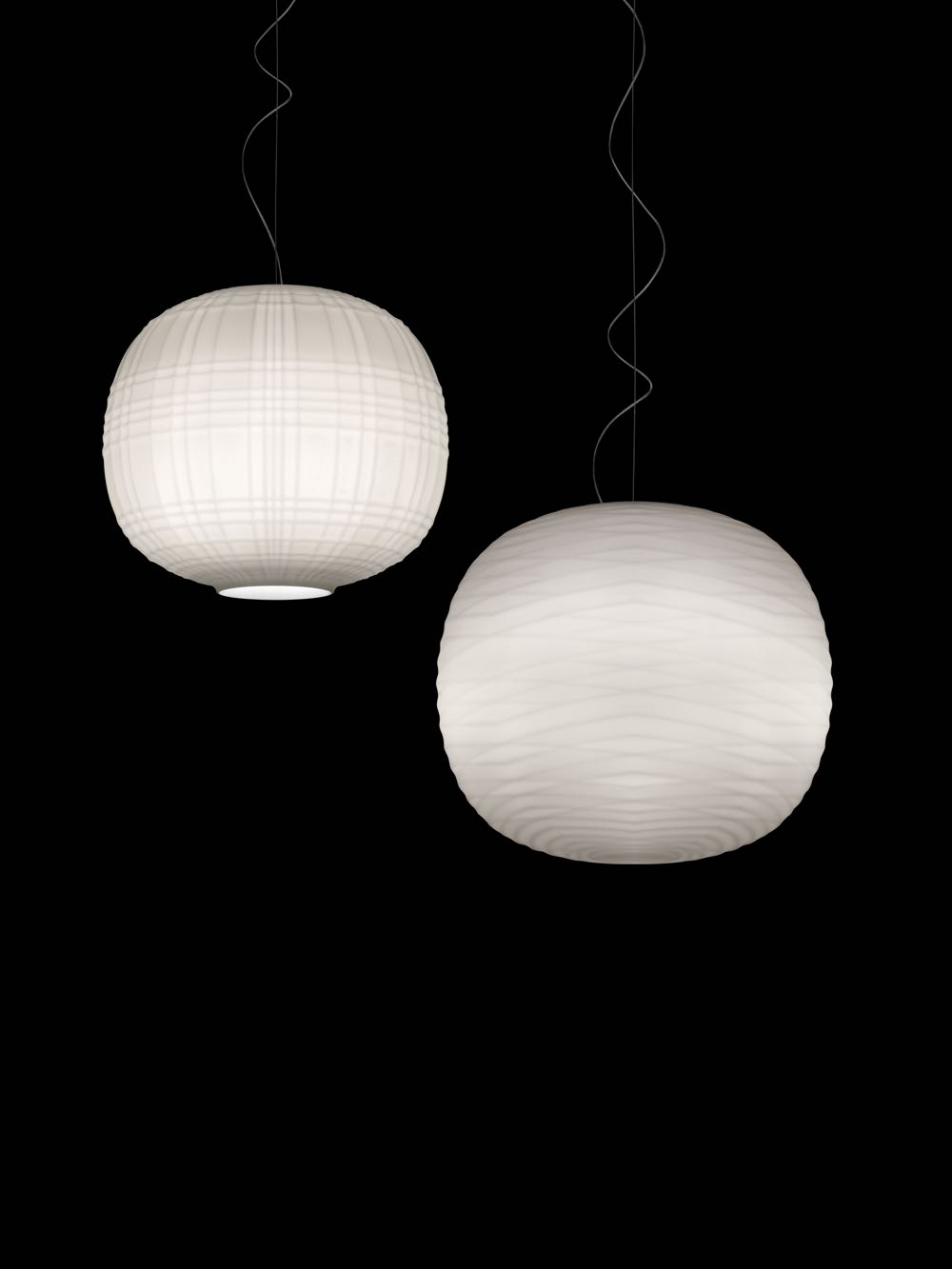 The 'Tartan' and 'Gem' pendants in opaline glass by Ludovica and Roberto Palomba for  Foscarini.