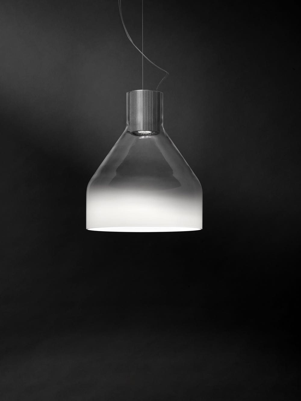 'Caiigo' by Marco Zito for Foscarini changes from clear to white glass and has a beautiful misty quality.