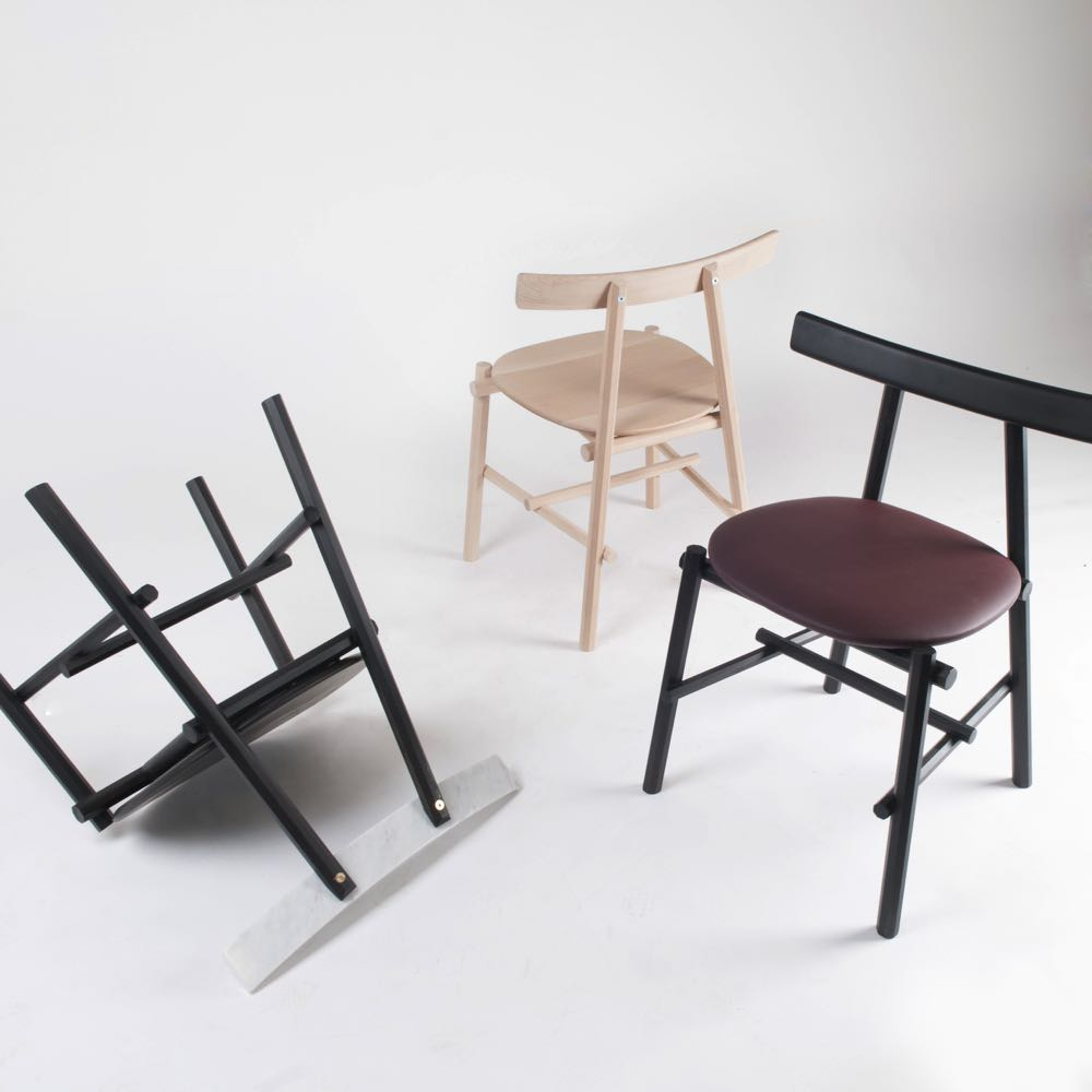 The 'Rōnin' chair by Frederick Werner and Emil Lagoni Valbak. The chair on the left has a marble back rest.