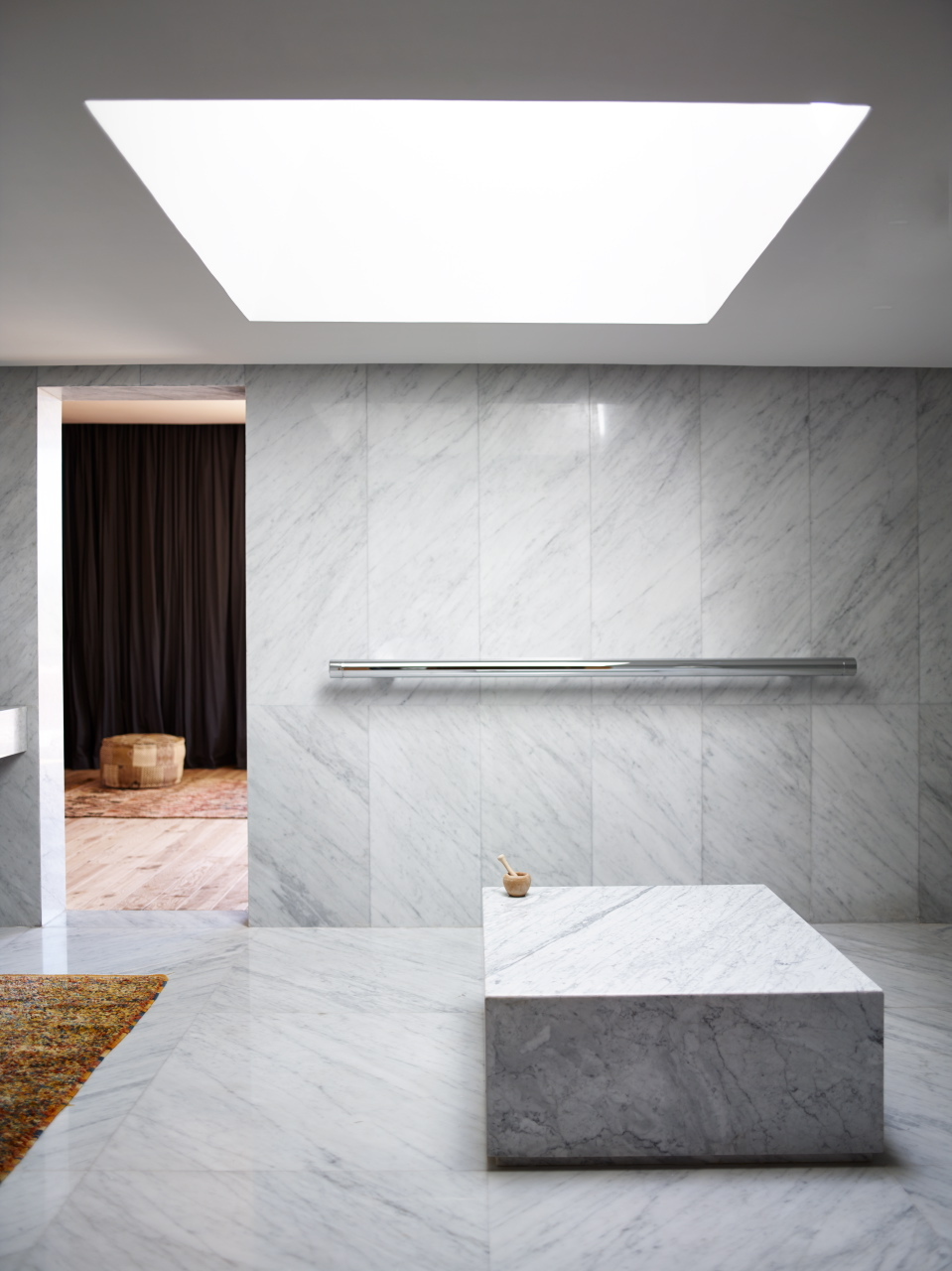 The slick marble bathroom of 'Villa E' is a contrast to it's rough brick exterior.