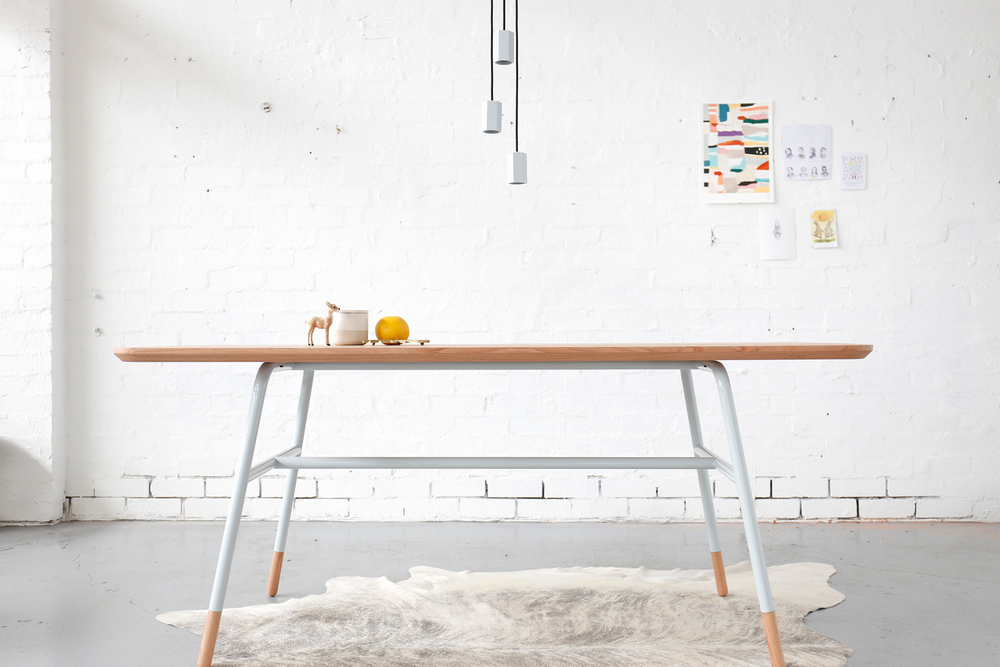 Archier Studio's 'Otway' table combines timber and metal in a smooth, uncomplicated way.