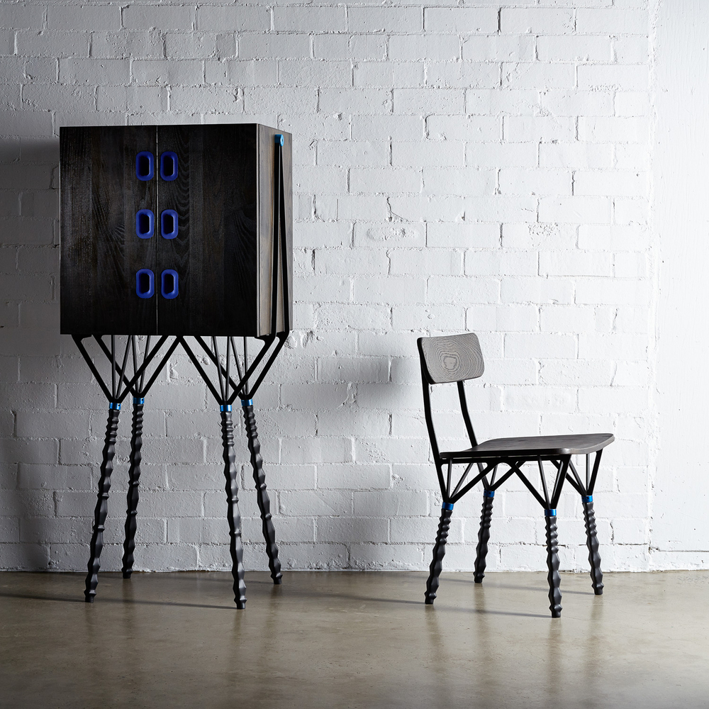 The legs of the 'Shrink' cabinet and chair by daast use laser-cut aluminium and heat shrink rubber tubing. The electric blue handles are moulded in silicone. Photo Rodrick Bond.
