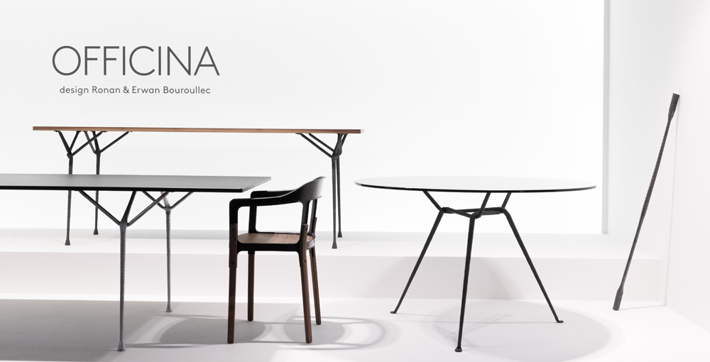 The Magis stand at Milan in 2014 featuring 'Officina' tables and a 'Steelwood' chair by Ronan & Erwan Bouroullec.