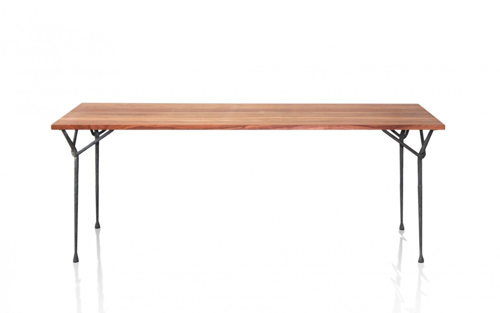 The 'Officina' table in walnut and wrought iron sells for approximately £3,000