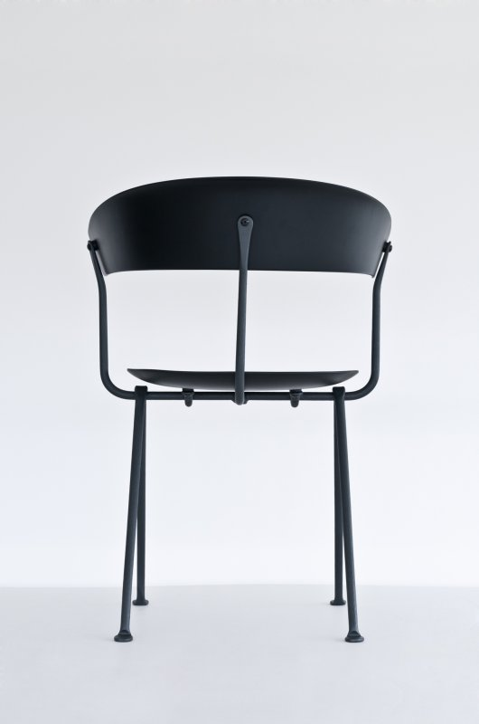 The rear of the new 'Officina' chair showing the beauty of it's shape and the refined beauty of its wrought iron frame.