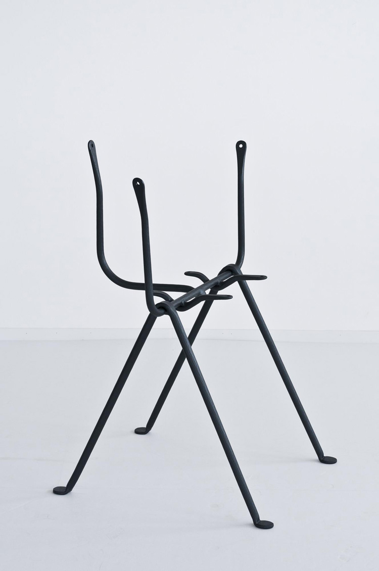The elegant framework of the 'Officina' chair.