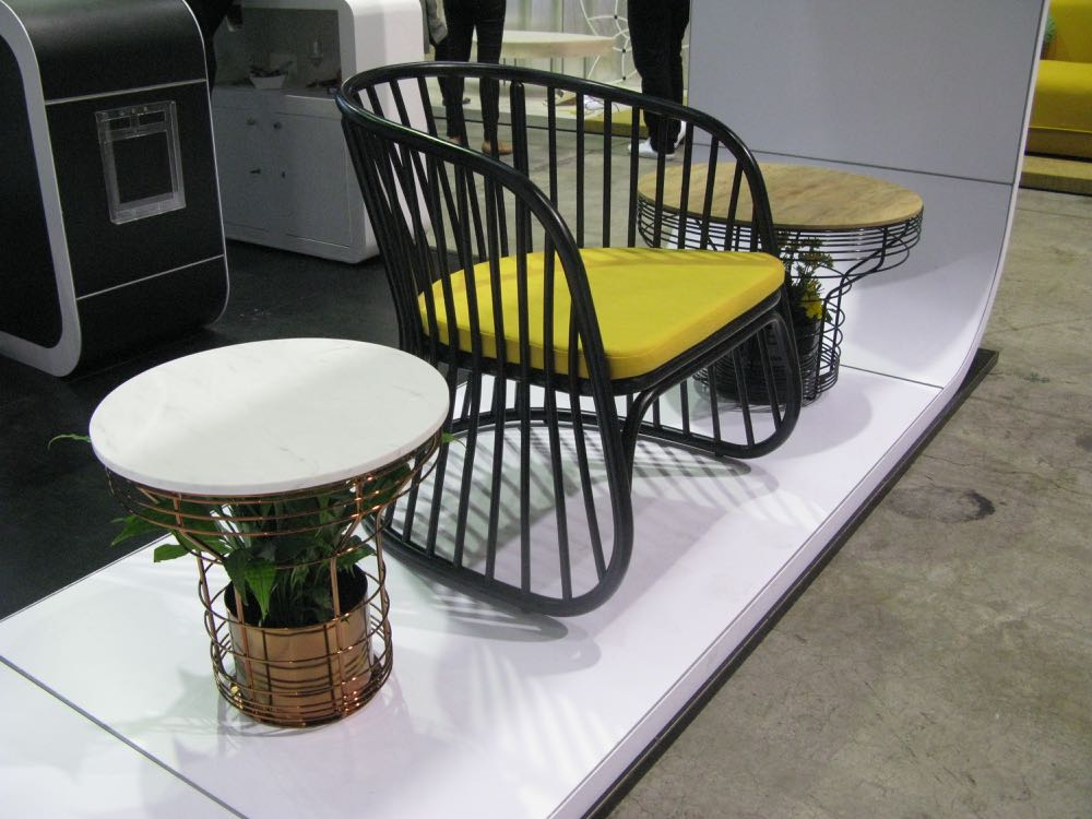 Dennis Abalos' new chair 'Lattice' comes in three variations and in natural or stained rattan.