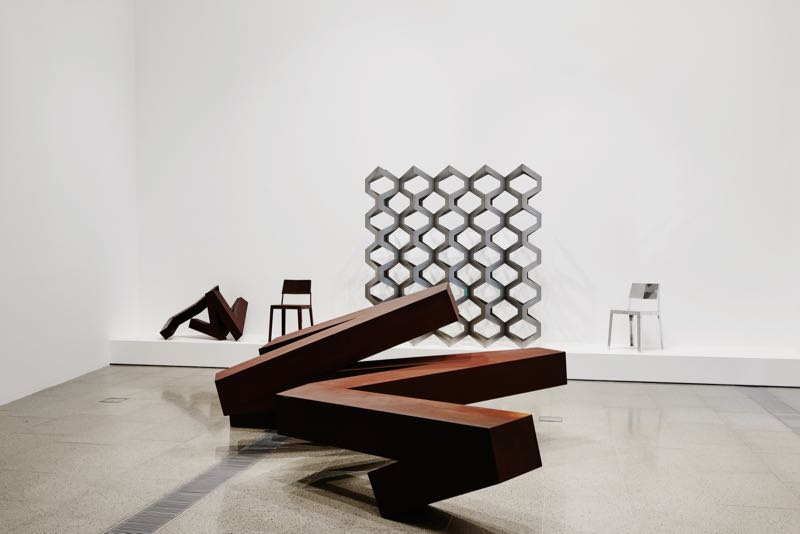 The architectural scale and bold geometric aesthetic of Korban & Flaubert. Shown are 'Hive' screen (centre), 'Absolute' chair, 'Stalker' sculpture & sculptural bench 'Iron in the Soul'. Photograph by Brooke Holm.