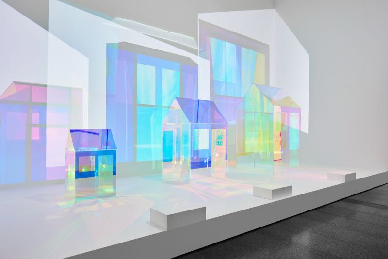 Adam Goodrum's 'Unfolding' installation of three perspex houses covered in diacroic film. Photograph by Brooke Holm.