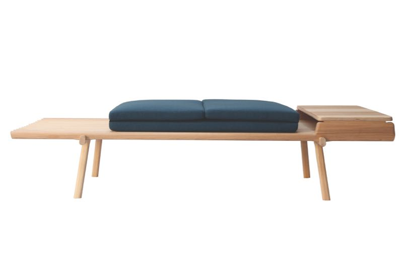 Studio 22's 'Horace' bench converts into a daybed by unfolding the cushions and removing the timber table to the right.