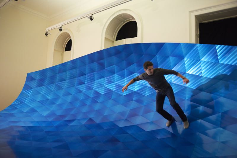 Surfing Alex Rasmussen's aluminium 'Wave' at Somerset House.