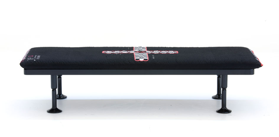 The bench version of the 'Charpoy' in embroidered black cotton fabric. The base is CNC machined timber.