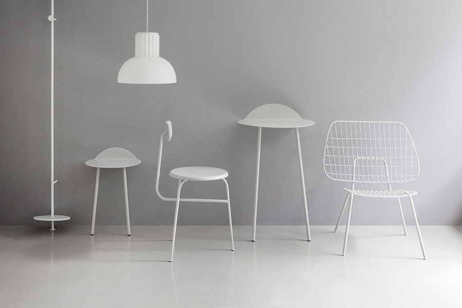 A line-up of Menu seating including Studio WM's 'Strings' lounge chair on the right. Previously called 'Lounge chair', both it and the dining chair are offered by Menu in white or black with optional Kvadrat seat.