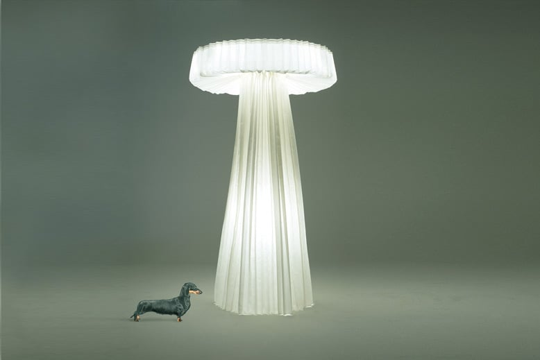 The PO/202 floor lamp was released by Cappellini in 2002. Made from pleated polyamide paper and steel wire, it demonstrates Sempé's natural abilities with paper.